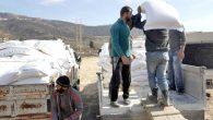 Suriyelilere 12 tırlık malzeme yardımı
