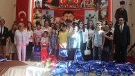 KMÇKD'den 250 Yurt Çocuğuna  Giysi Desteği